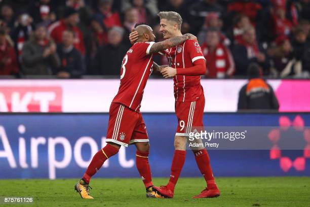 Robert Lewandowski of Bayern Muenchen celebrates with Arturo Vidal of Bayern Muenchen after he scored his teams second goal to make it 20 during the...