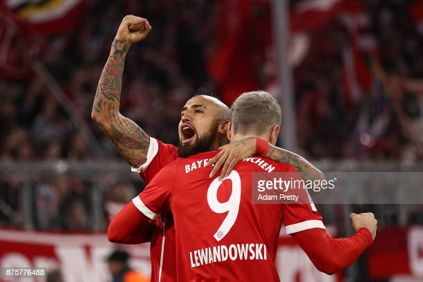 Robert Lewandowski of Bayern Muenchen celebrates with Arturo Vidal of Bayern Muenchen after he scored his teams third goal to make it 30 during the...