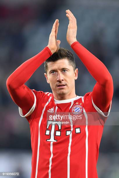 Robert Lewandowski of Bayern Muenchen celebrates with David Alaba of Bayern Muenchen after he scored a goal to make it 12 during the Bundesliga match...
