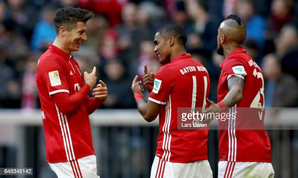 Robert Lewandowski of Bayern Muenchen celebrates with Douglas Costa of Bayern Muenchen during the Bundesliga match between Bayern Muenchen and...