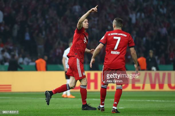 Robert Lewandowski of Bayern Muenchen celebrates with Franck Ribery of Bayern Muenchen after he scored a goal to make it 11 during the DFB Cup final...