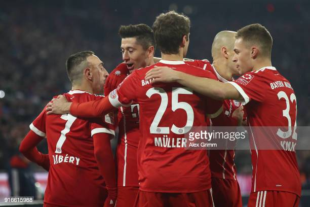 Robert Lewandowski of Bayern Muenchen celebrates with his team after he scored to make it 10 during the Bundesliga match between FC Bayern Muenchen...
