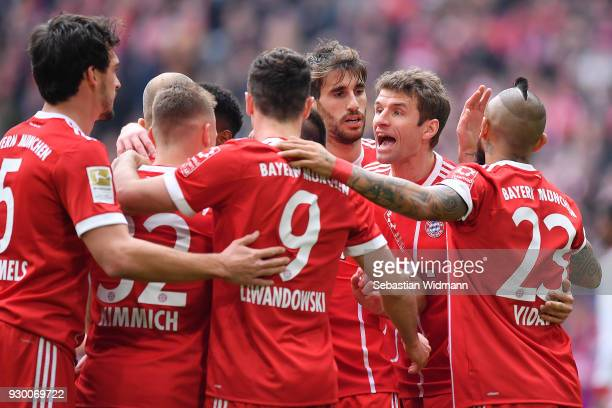 Robert Lewandowski of Bayern Muenchen celebrates with his team after he scored a goal to make it 20 during the Bundesliga match between FC Bayern...