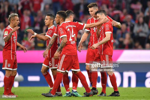 Robert Lewandowski of Bayern Muenchen celebrates with his teamafter he scored a goal to make it 51 during the Bundesliga match between FC Bayern...