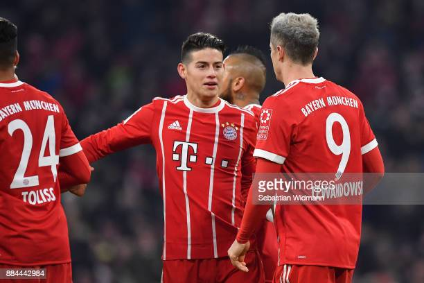 Robert Lewandowski of Bayern Muenchen celebrates with James Rodriguez of Bayern Muenchen after he scored a penalty goal to make it 31 during the...