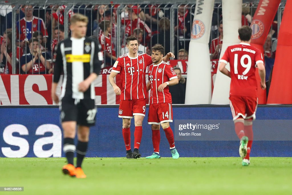 Robert Lewandowski of Bayern Muenchen (k) celebrates with Juan Bernat of Bayern Muenchen after he scored a goal to make it 5:1 during the Bundesliga match between FC Bayern Muenchen and Borussia Moenchengladbach at Allianz Arena on April 14, 2018 in Munich, Germany.