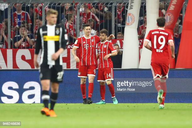 Robert Lewandowski of Bayern Muenchen celebrates with Juan Bernat of Bayern Muenchen after he scored a goal to make it 51 during the Bundesliga match...
