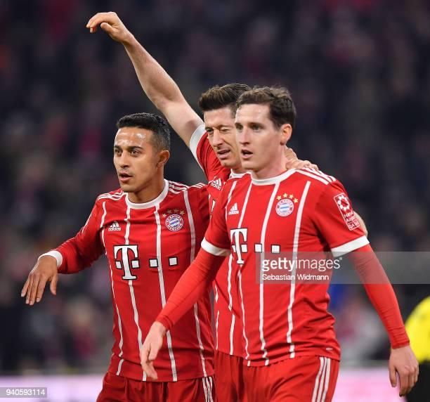 Robert Lewandowski of Bayern Muenchen celebrates with Sebastian Rudy of Bayern Muenchen and Thiago Alcantara of Bayern Muenchen after he scored to...