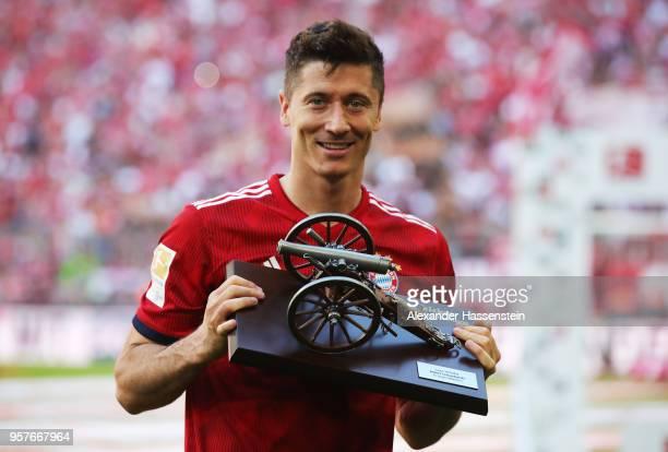 Robert Lewandowski of Bayern Muenchen celebrates with the award for top goal scorer in the Bundesliga during the Bundesliga match between FC Bayern...