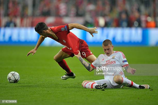 Robert Lewandowski of Bayern Muenchen challenges Victor Lindeloef of Benfica during the UEFA Champions League Quarter Final first leg match between...
