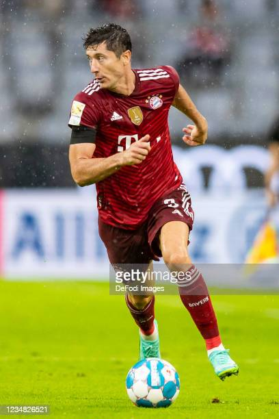 Robert Lewandowski of Bayern Muenchen compete during the Bundesliga match between FC Bayern Muenchen and 1. FC Koeln at Allianz Arena on August 22,...