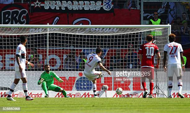 Robert Lewandowski of Bayern Muenchen converts the panalty to score his team's opening goal during the Bundesliga match between FC Ingolstadt and FC...