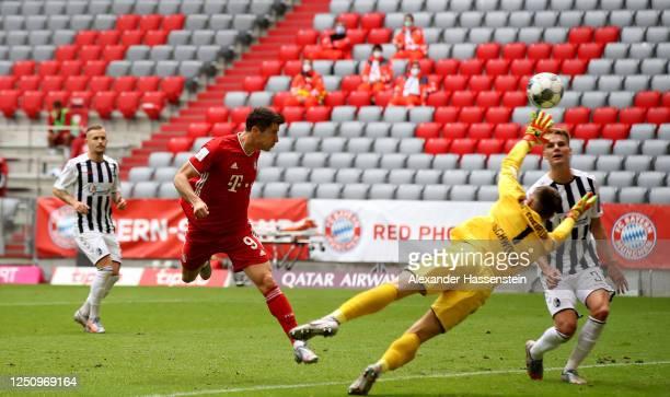 Robert Lewandowski of Bayern Muenchen head's his teams 2nd goal during the Bundesliga match between FC Bayern Muenchen and Sport-Club Freiburg at...