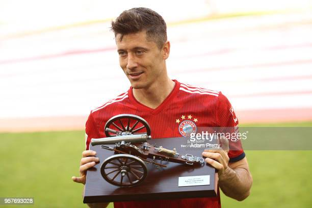 Robert Lewandowski of Bayern Muenchen hold the trophy for the top goalscorer of the season after the Bundesliga match between FC Bayern Muenchen and...