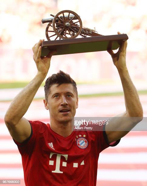Robert Lewandowski of Bayern Muenchen holds the trophy for top goalscorer of the season after the Bundesliga match between FC Bayern Muenchen and VfB...