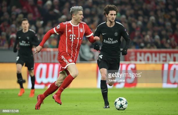 Robert Lewandowski of Bayern Muenchen in action with Adrien Rabiot of Paris SaintGermain during the UEFA Champions League group B match between...