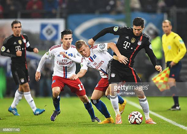 Robert Lewandowski of Bayern Muenchen is challenged by Matthias Ostrzolek of Hamburger during the DFB Cup match between Hamburger SV and FC Bayern...