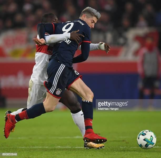 Robert Lewandowski of Bayern Muenchen is chased by Chadrac Akolo of Stuttgart during the Bundesliga match between VfB Stuttgart and FC Bayern...