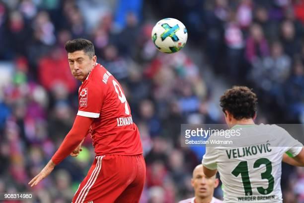 Robert Lewandowski of Bayern Muenchen jumps for a header during the Bundesliga match between FC Bayern Muenchen and SV Werder Bremen at Allianz Arena...