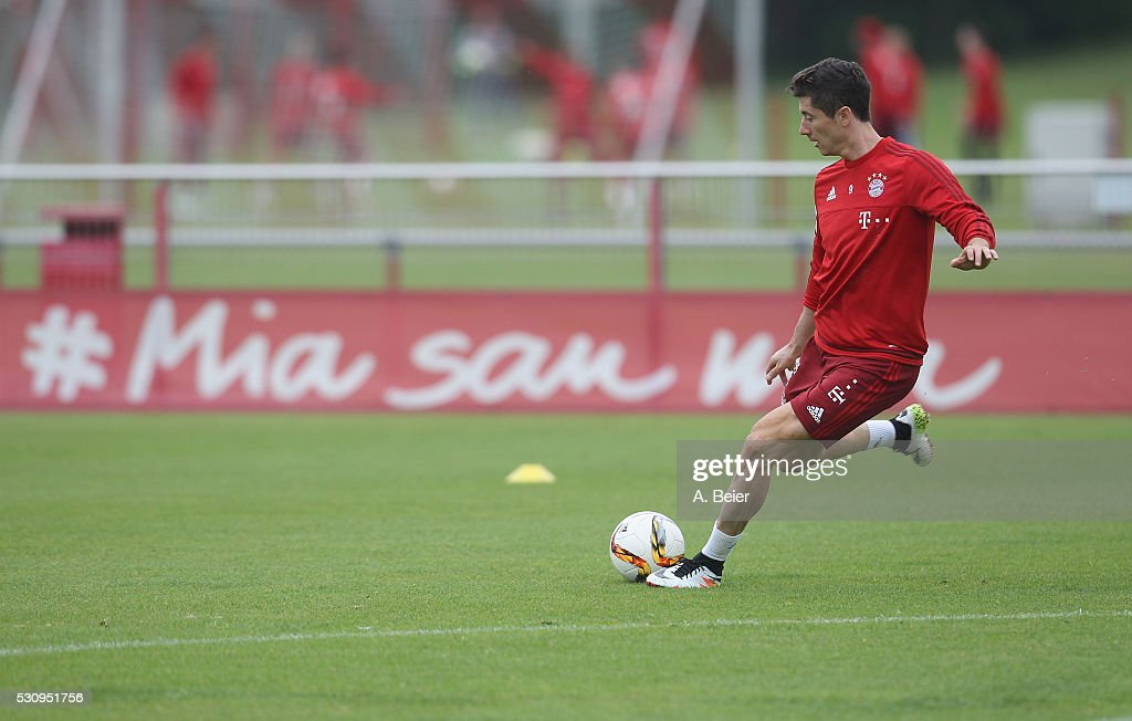Robert Lewandowski of Bayern Muenchen kicks the ball during a training session at FC Bayern Muenchen training ground on May 12, 2016 in Munich, Germany.