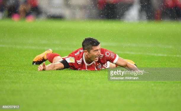 Robert Lewandowski of Bayern Muenchen lies on the pitch during the Bundesliga match between FC Bayern Muenchen and Bayer 04 Leverkusen at Allianz...
