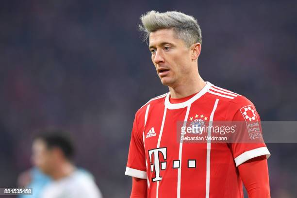 Robert Lewandowski of Bayern Muenchen looks on during the Bundesliga match between FC Bayern Muenchen and Hannover 96 at Allianz Arena on December 2...