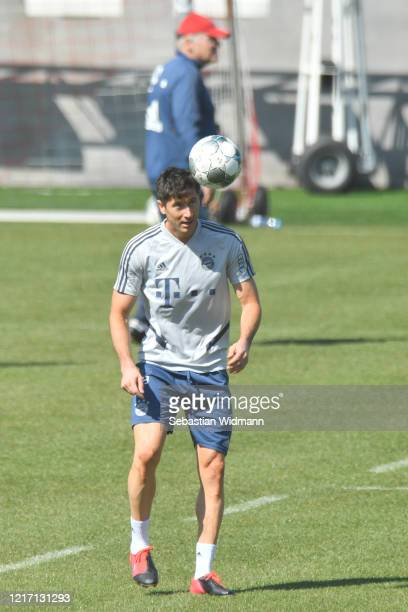 Robert Lewandowski of Bayern Muenchen plays with a ball during a training session at Saebener Strasse training ground on April 06 2020 in Munich...