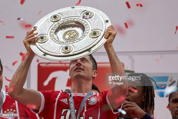 Robert Lewandowski of Bayern Muenchen poses with the Championship trophy in celebration of the 67th German Championship title following the...