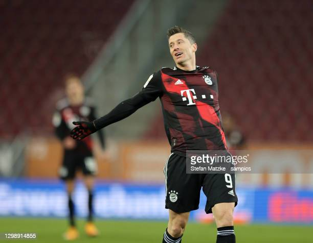 Robert Lewandowski of Bayern Muenchen reacts during the Bundesliga match between FC Augsburg and FC Bayern Muenchen at WWK-Arena on January 20, 2021...