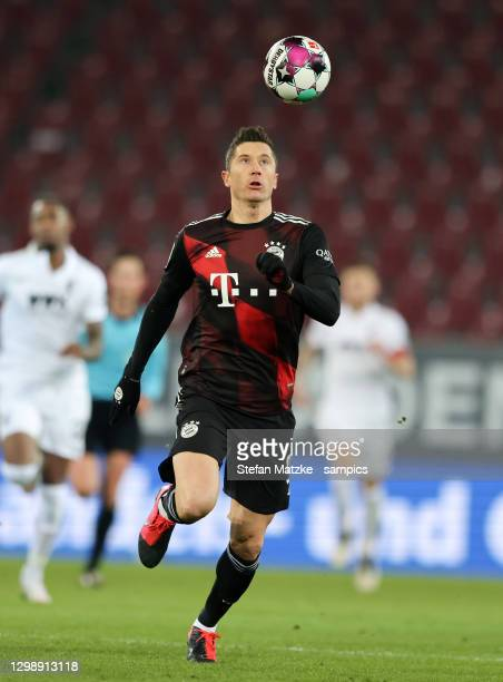 Robert Lewandowski of Bayern Muenchen runs with a ball during the Bundesliga match between FC Augsburg and FC Bayern Muenchen at WWK-Arena on January...