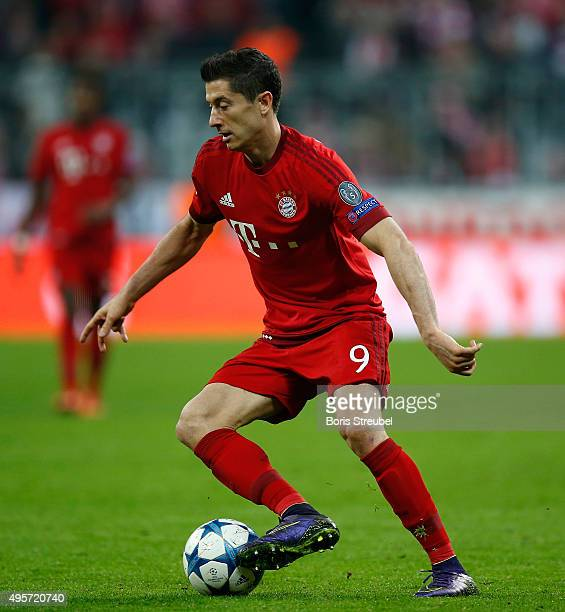 Robert Lewandowski of Bayern Muenchen runs with the ball during the UEFA Champions League Group F match between FC Bayern Muenchen and Arsenal FC at...