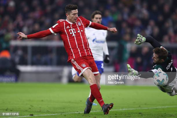 Robert Lewandowski of Bayern Muenchen scores a goal past goalkeeper Ralf Faehrmann of Schalke to make it 10 during the Bundesliga match between FC...