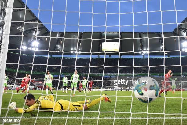 Robert Lewandowski of Bayern Muenchen scores a goal past goalkeeper Koen Casteels of Wolfsburg from the penalty spot to make it 12 during the...