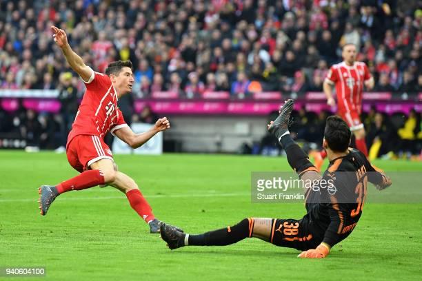 Robert Lewandowski of Bayern Muenchen scores a goal past goalkeeper Roman Buerki of Dortmund to make it 10 during the Bundesliga match between FC...