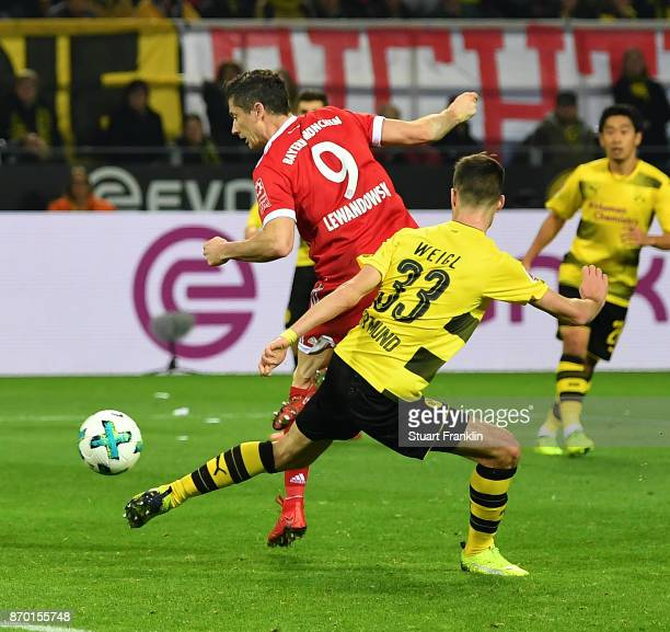 Robert Lewandowski of Bayern Muenchen scores a goal to make it 02 during the Bundesliga match between Borussia Dortmund and FC Bayern Muenchen at...