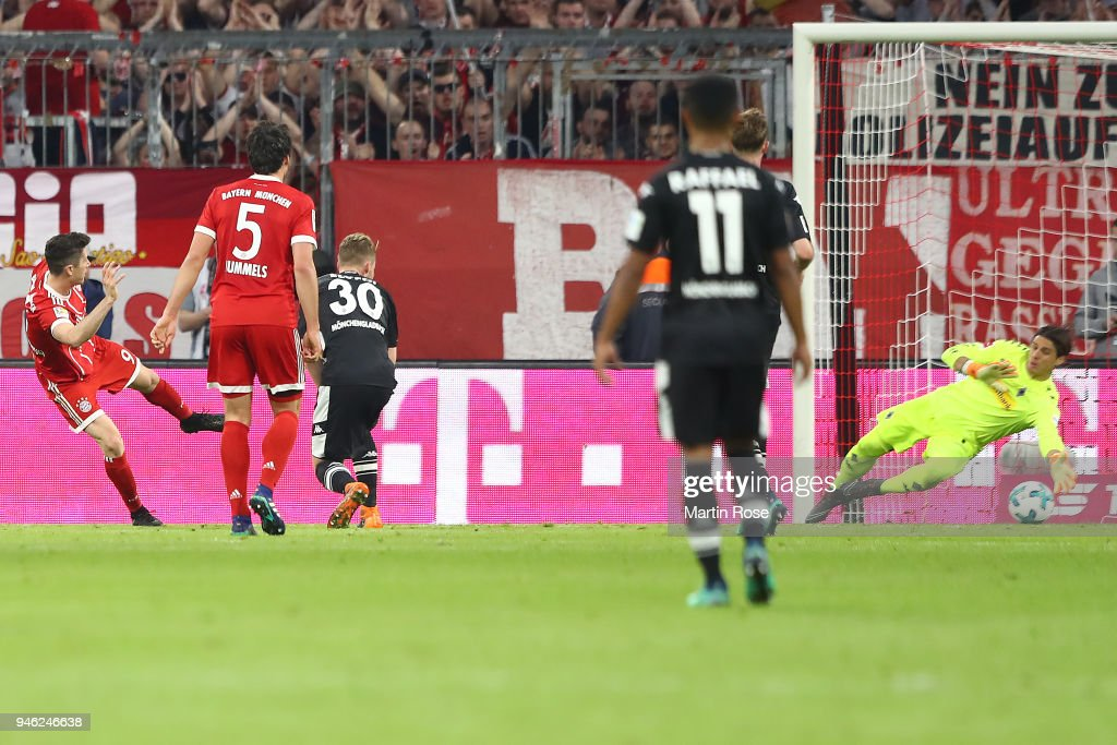 Robert Lewandowski of Bayern Muenchen (c) scores a goal to make it 5:1 during the Bundesliga match between FC Bayern Muenchen and Borussia Moenchengladbach at Allianz Arena on April 14, 2018 in Munich, Germany.