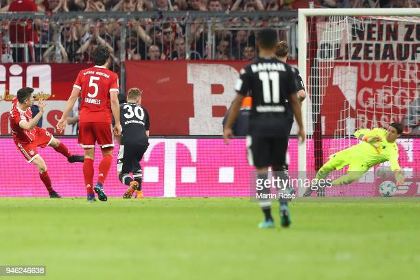 Robert Lewandowski of Bayern Muenchen scores a goal to make it 51 during the Bundesliga match between FC Bayern Muenchen and Borussia...