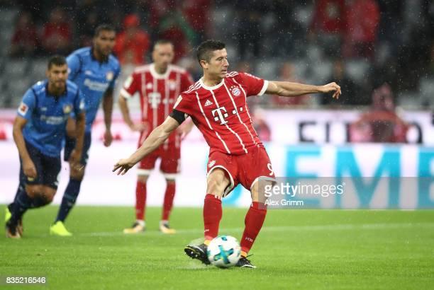 Robert Lewandowski of Bayern Muenchen scores a penalty during the Bundesliga match between FC Bayern Muenchen and Bayer 04 Leverkusen at Allianz...