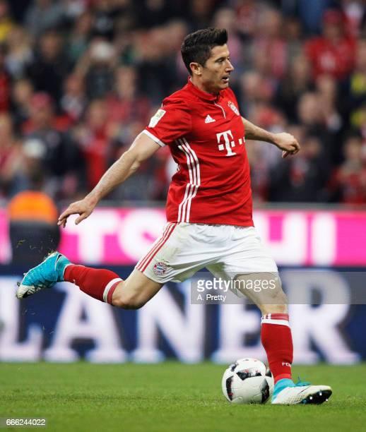Robert Lewandowski of Bayern Muenchen scores a penalty goal during the Bundesliga match between Bayern Muenchen and Borussia Dortmund at Allianz...