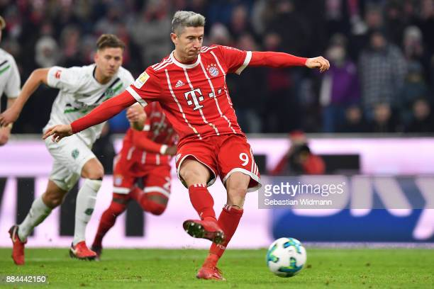 Robert Lewandowski of Bayern Muenchen scores a penalty goal to make it 31 during the Bundesliga match between FC Bayern Muenchen and Hannover 96 at...