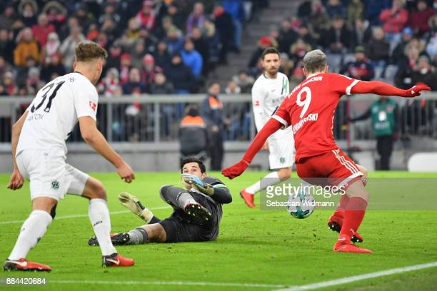 Robert Lewandowski of Bayern Muenchen scores but the goal is later disallowed after video review during the Bundesliga match between FC Bayern...
