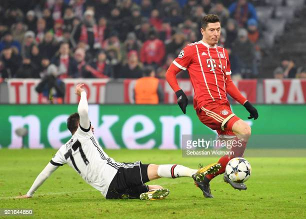 Robert Lewandowski of Bayern Muenchen scores his sides fifth goal during the UEFA Champions League Round of 16 First Leg match between Bayern...