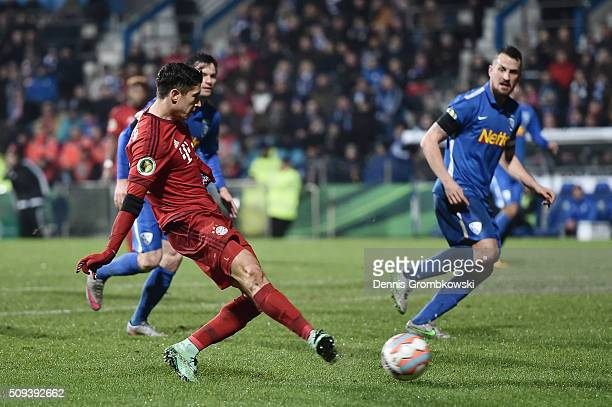 Robert Lewandowski of Bayern Muenchen scores his side's first goal during the DFB Cup quarter final match between VfL Bochum and Bayern Muenchen at...