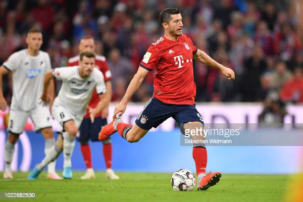 Robert Lewandowski of Bayern Muenchen scores his teams second goal via a penalty kick during the Bundesliga match between FC Bayern Muenchen and TSG...