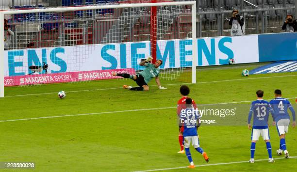 Robert Lewandowski of Bayern Muenchen scores his team's third goal during the Bundesliga match between FC Bayern Muenchen and FC Schalke 04 at...