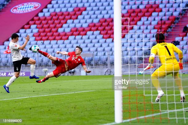 Robert Lewandowski of Bayern Muenchen scores his teams third goal past goalkeeper Yann Sommer of Borussia Moenchengladbach during the Bundesliga...