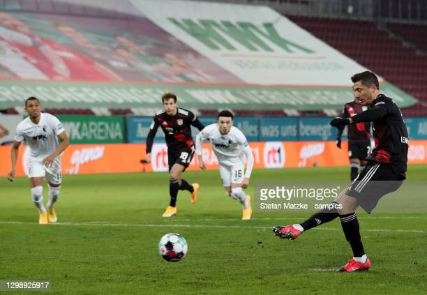 Robert Lewandowski of Bayern Muenchen scores the goal 0:1 during the Bundesliga match between FC Augsburg and FC Bayern Muenchen at WWK-Arena on...