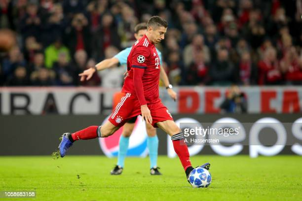 Robert Lewandowski of Bayern Muenchen scores the opening goal with a penalty during the Group E match of the UEFA Champions League between FC Bayern...