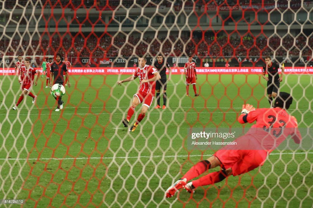 Robert Lewandowski of Bayern Muenchen scores the opening goal with a penalty against Petr Cech, keeper of Arsenal during the Audi Football Summit 2017 match between Bayern Muenchen and Arsenal FC at Shanghai Stadium during the Audi Summer Tour 2017 on July 19, 2017 in Shanghai, China.