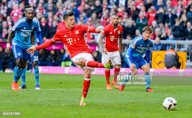 Robert Lewandowski of Bayern Muenchen scores the second goal for his team with a penalty during the Bundesliga match between Bayern Muenchen and...